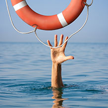 Lifebuoy for drowning man in sea or ocean water. Insurance conce